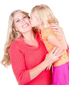 Daughter kissing mother — Stock Photo