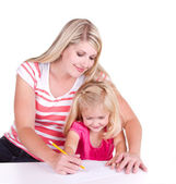 Mother helping daughter write alphabet — Stock Photo