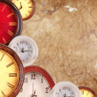 Stock Photo: Many clocks on a paper background