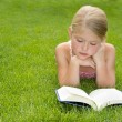 Girl reading outdoors — Stock Photo #11978012