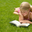 Girl reading in the grass — Stock Photo #11978022