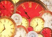 Many clocks filling background — Stock Photo