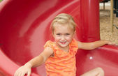 Little girl on slide — Stock Photo