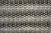 Gray punched aluminum plate — Stock Photo