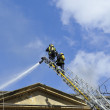 Fire engines at the scene of city fire - Stock Photo