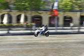 Scooter on the Avenue des Champs Elysees — Stock Photo