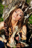 Sexy tribal female with tottoo on her face — Stock Photo