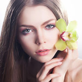 Healthy clean girl face - healthcare and beauty, flower orchid — Stock Photo