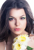 Beauty. Sensual woman face with bouquet of flowers — Stockfoto
