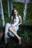 Nature. Flowering garden. Pretty sexy fashion woman sitting — Stock Photo