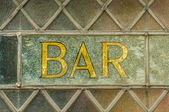 Old gold bar sign in a pub window — Stock Photo