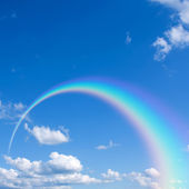 Sky with clouds and rainbow — Stock Photo