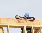 Carpenter hammering in nail — Stock Photo