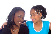 African american Mother and daughter smiling — Stock Photo