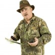 Hunter with GPS and map — Stock Photo
