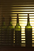 Four bottles of wine for testing in the lab — Stock Photo
