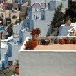 Patios on greek island of Santorini looking down into caldera — Stock Photo #11028106