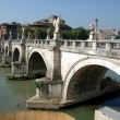 Ponte St. Angelo looking across the Tevere river (Tiber) from Castel St. Angelo - Stock Photo