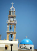 Bell tower with clock and dome on the greek island of Santorini — Stock Photo