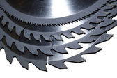 A nest of Circular saw blades of different sized teeth — Stock Photo