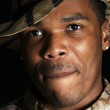 Young African American man in hunting hat and shirt - closeup — Stock Photo #11034166