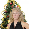 Woman standing in front of Christmas tree — Stock Photo
