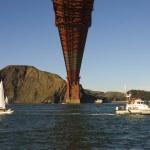 Golden gate bridge from beneath with coast guard rescue — Stock Photo