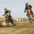 Dirt bike racers on track — Stock Photo #11035143