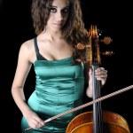 Cellist on a black background — Stock Photo