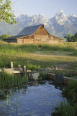 Old Mormon Barn against the tetons — Stock Photo