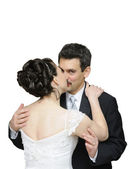 Bride and groom kissing, isolated on white — Stock Photo