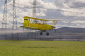 Low flying crop duster — Stock Photo