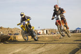 Dirt bike racers on track — Stock Photo