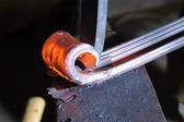 Blacksmith working on decorative handrail — Stock Photo