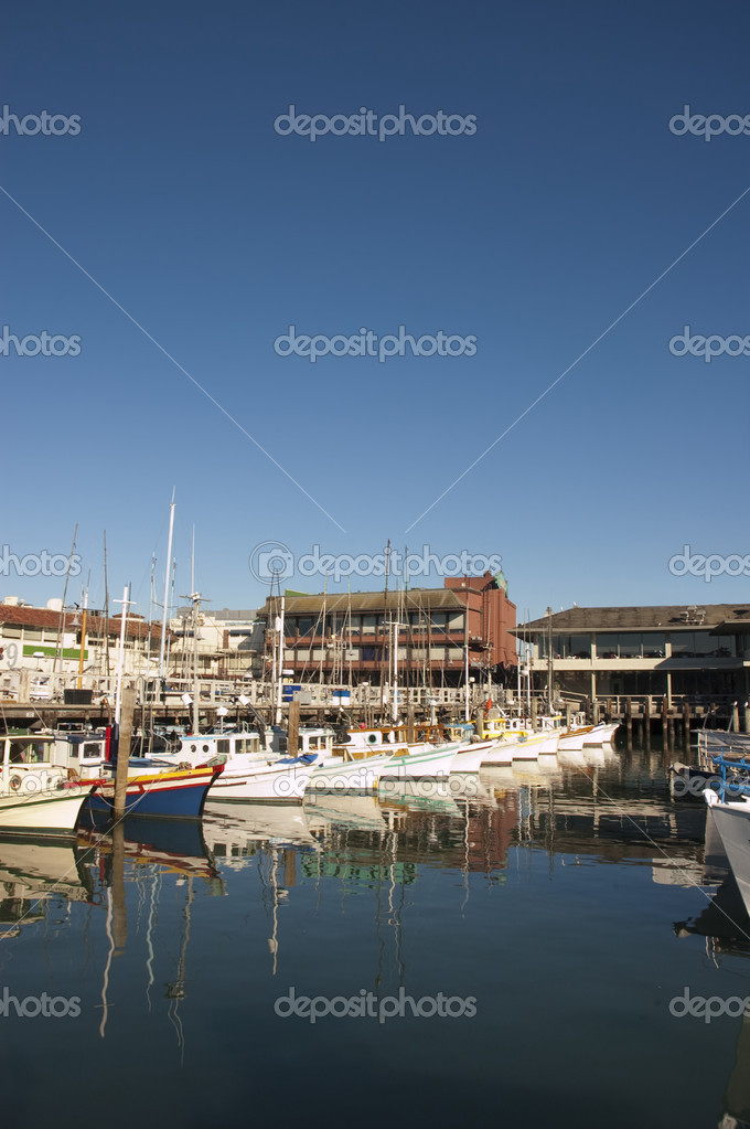 Fisherman&#039;s Wharf in San Francisco with the fleet in harbor and reflected in the water  Stock Photo #11035098