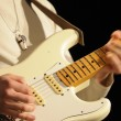 Closeup of guitarist playing in lve concert — Stock Photo