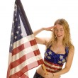 Attractive female American Patriot with flag - Stock Photo