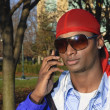 Young African American man on a cell phone - Stock Photo