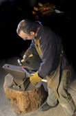 Blacksmith working on decorative handrail — Stock Photo