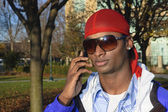 Young African American man on a cell phone — Stock Photo