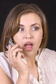 Pretty hispanic girl on a cell phone — Stock Photo
