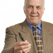 Older salesman with pen — Stock Photo