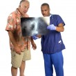 Doctor explaining x-ray to surprised patient — Stock Photo