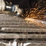 Blacksmith working on decorative handrail — Stock Photo #11111023
