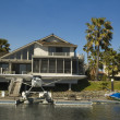 Executive house on the water with seaplane - Stock Photo