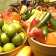 Bowls of limes and peppers — Stock Photo
