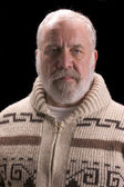 Old man with beard in sweater like Ernest Hemingway — Stock Photo