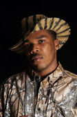 Young African American man in camo — Stock Photo