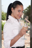 Beautiful african american woman smiling while drinking a glass — Stock Photo