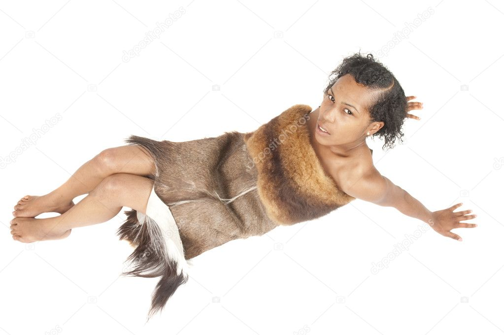 Beautiful black woman reclining, wrapped in a animal furs, isolated against a white background — Foto Stock #11110823